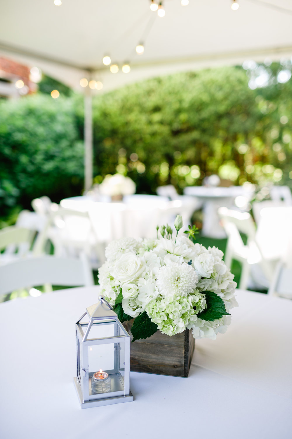 40th Anniversary Party  White and Green Centerpieces  Table Candles  Planning by Wrap It Up Parties