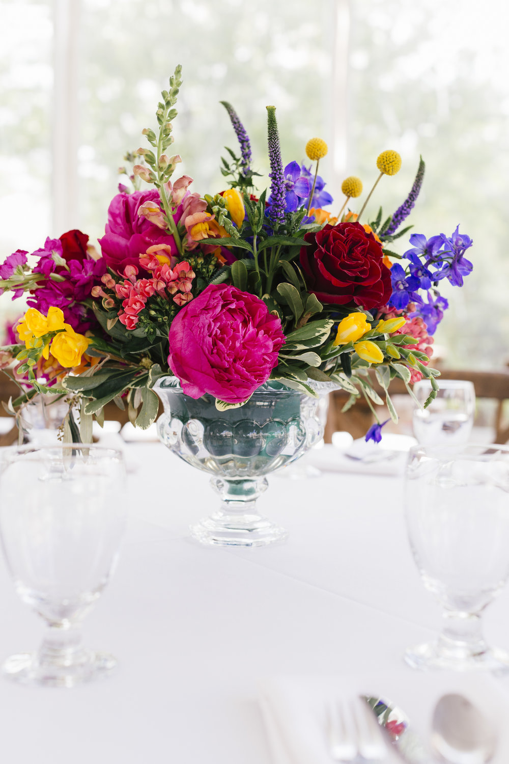 Bright and Colorful Flower Arrangement  Indian Wedding  Planning by Wrap It Up Parties