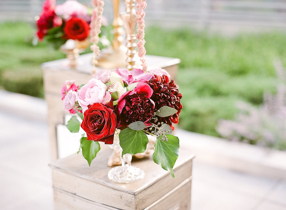 Red Floral Arrangements  Planning by Wrap It Up Parties