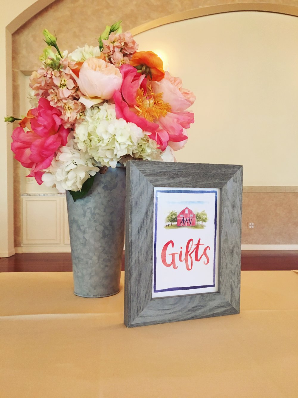 Bridal Shower Gift Table  Bright Floral Arrangement  Planning by Wrap It Up Parties