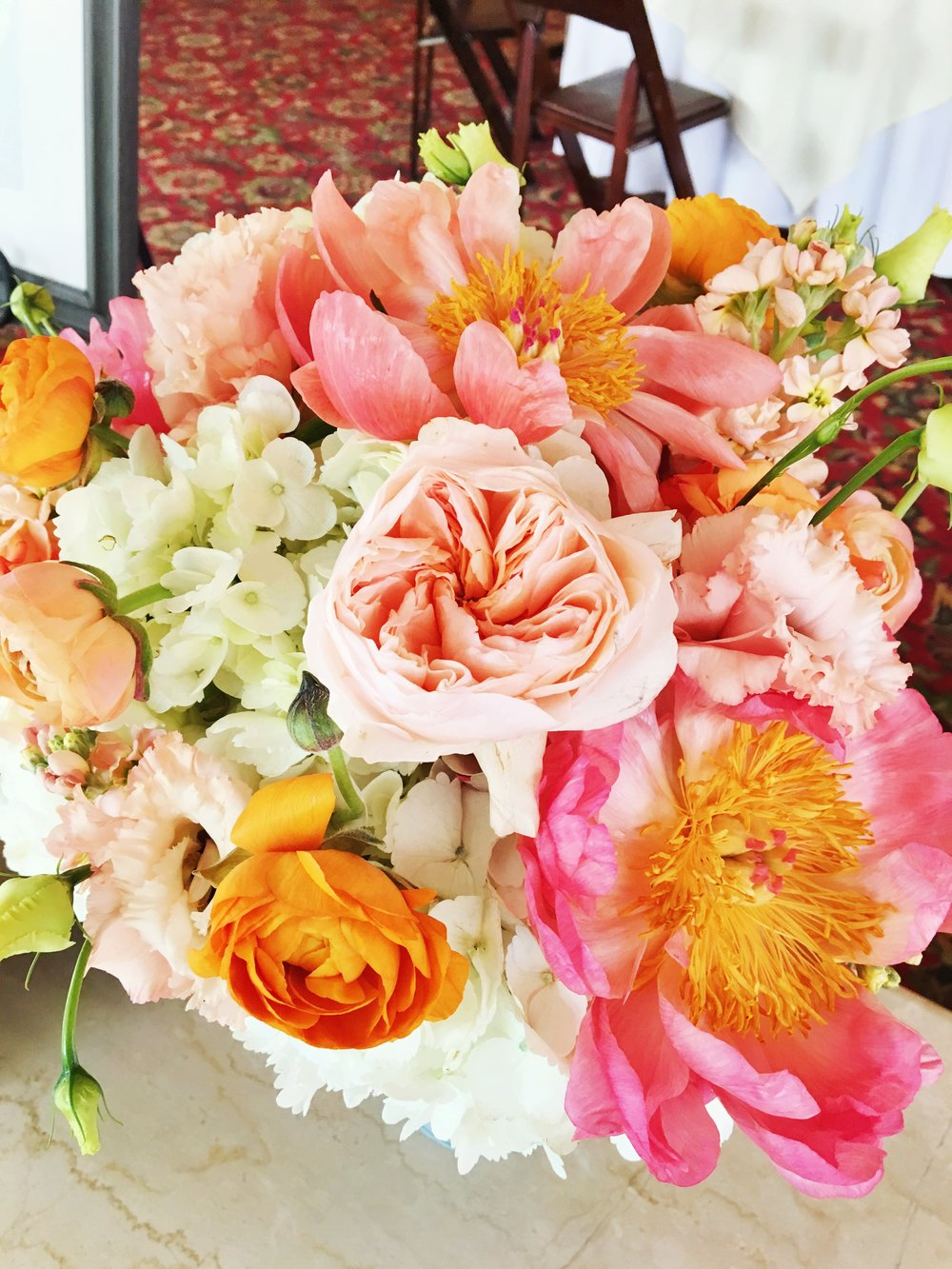 Bright Floral Arrangement  Barn Bridal Shower  Planning by Wrap It Up Parties