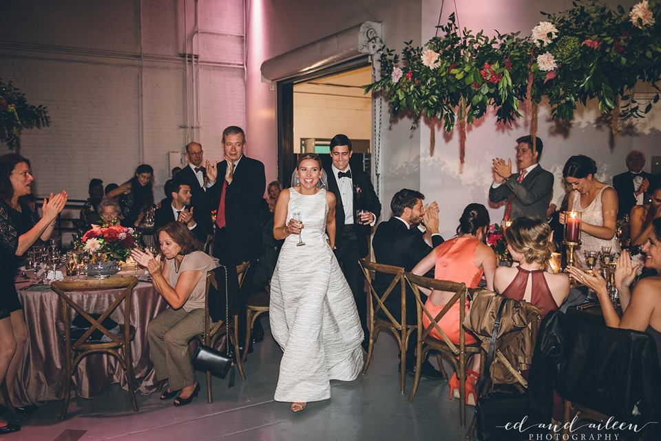 Bride and Groom Entering Reception  Planning by Wrap It Up Parties