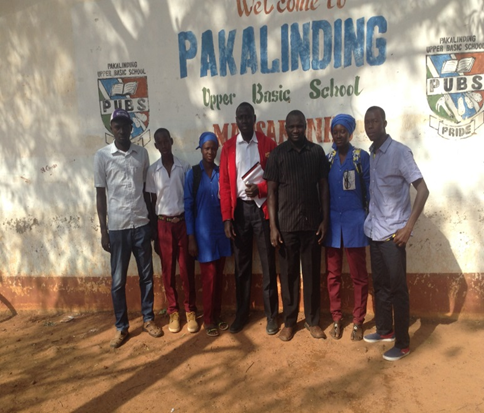Abdou and NSGA Peer Health Educators, teachers, and the school principal after a monitoring session .