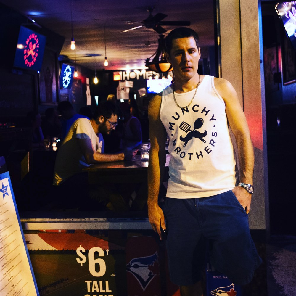 Dudes are loving our men's tanks. We're working on colours, but the black-on-white's killer.