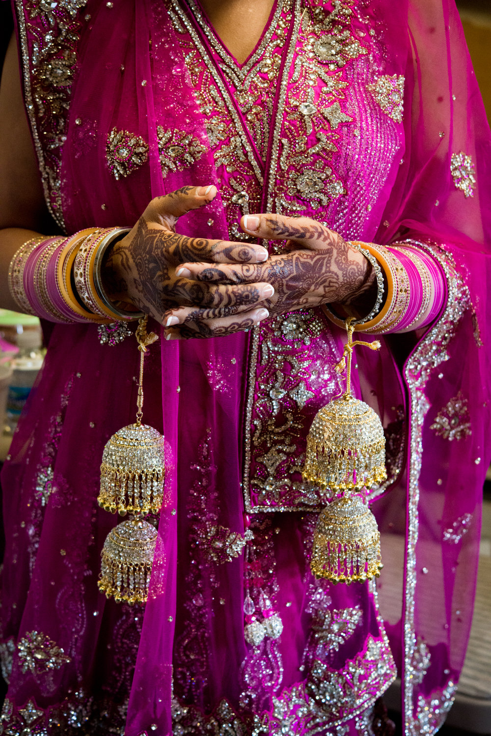 Brides hands with henna