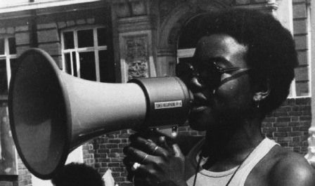 Olive Morris speaking through a megaphone