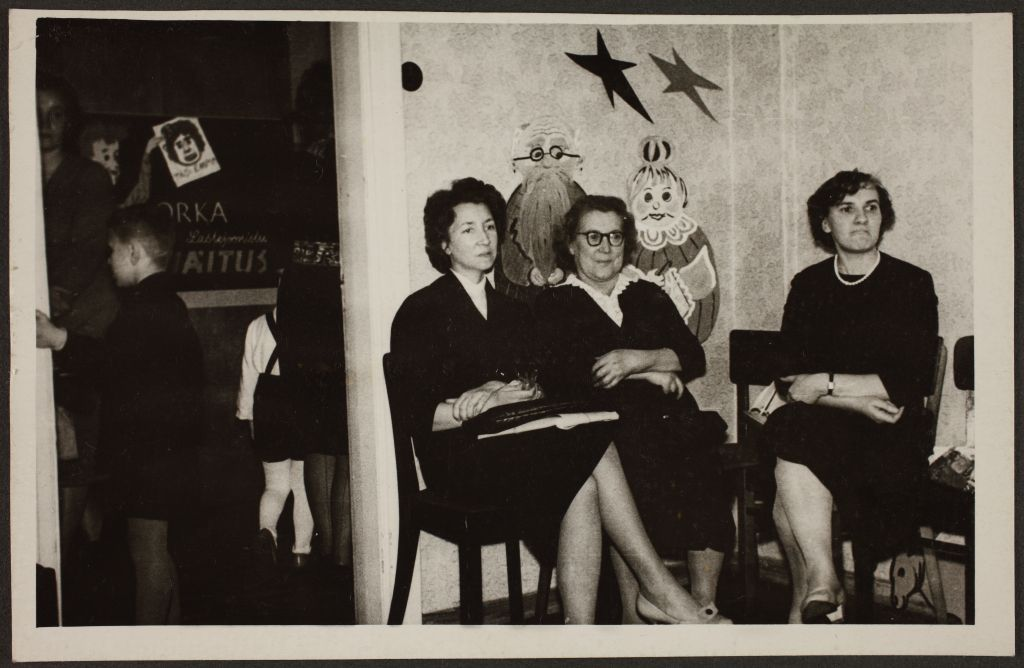 Women sat at a new year's party, 1960