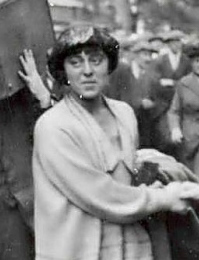 Photograph of Minnie Lansbury cheered by grounds, on her way to prison in 1921