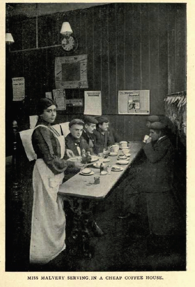Olive Christian Malvery in disguise as a waitress, serving coffee to a group of young men in caps