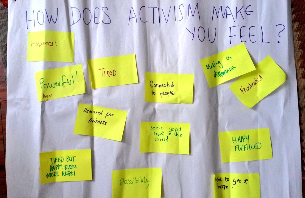 How does activism make you feel? answers on post its include powerful, tired, happy