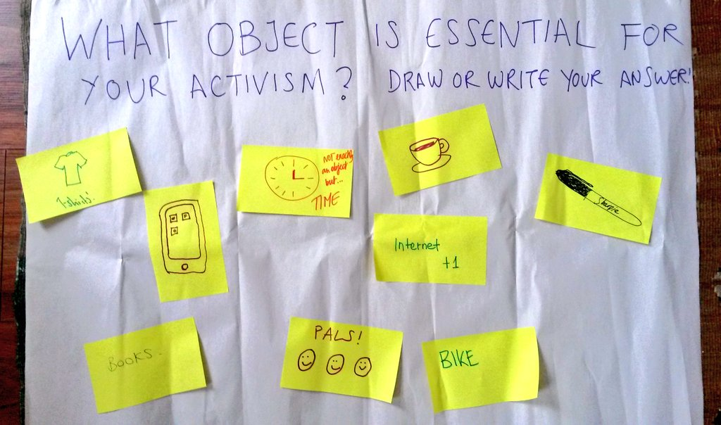 What object is essential for your activism? answers on post it notes include pen, bike, phone, friends, tea