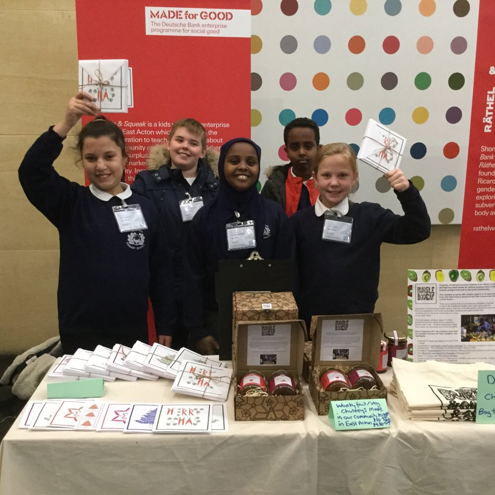 The Bubble & Squeakers at the Dutch Bank head offices in East London at their  #dbmadeforgood  market in December selling their Christmas Cards and Chutneys.  Please note the spotty Damien Hirst behind them!