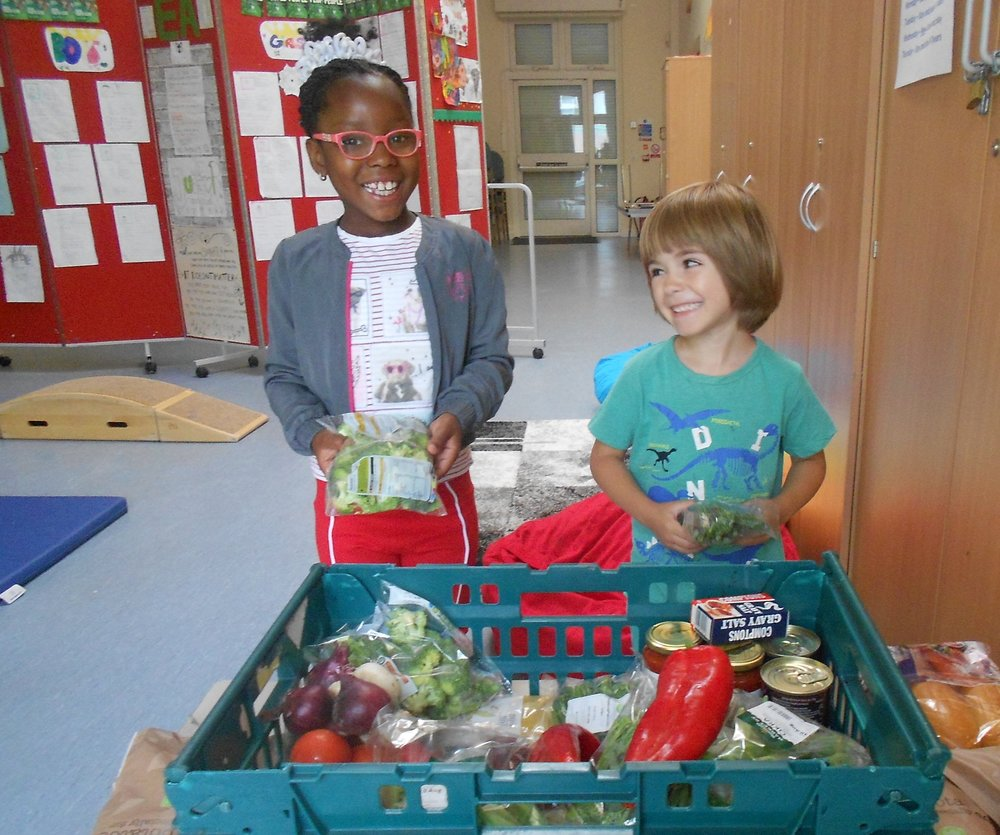 Holiday Club children packing the boxes for the Children's Centre cooking session over the summer holidays