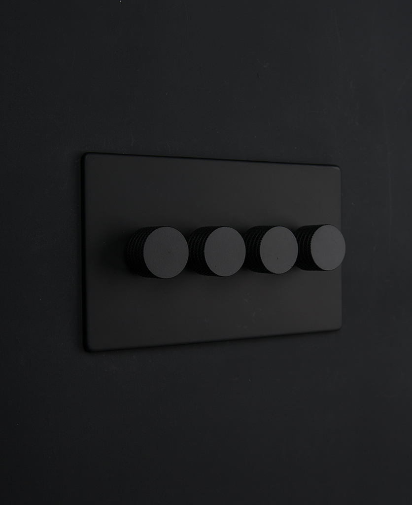 Black Quadruple Dimmer Switch