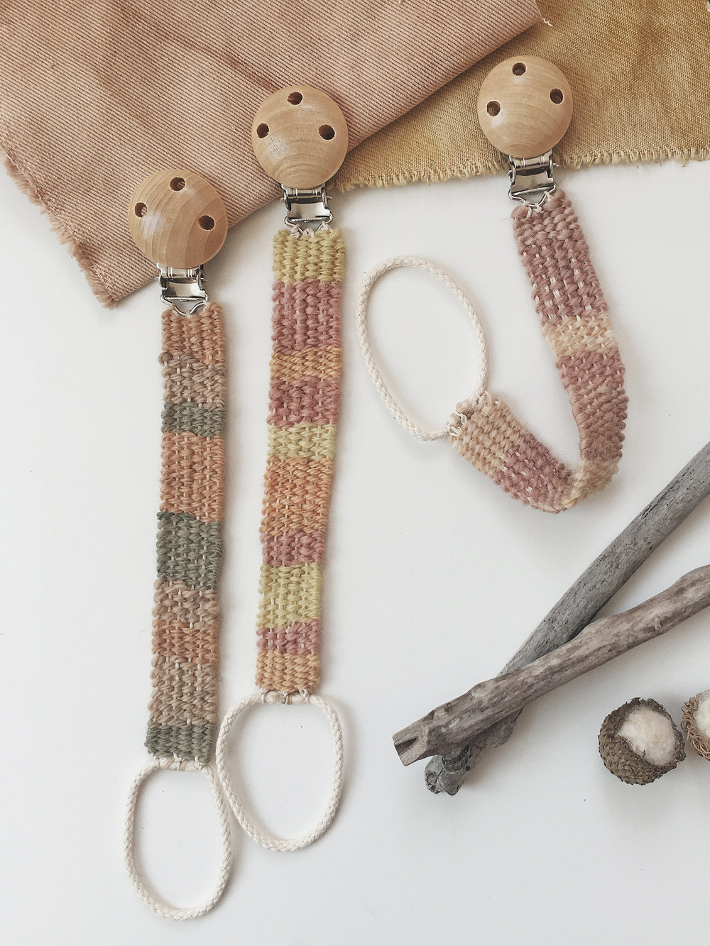 Handwoven pacifier clips