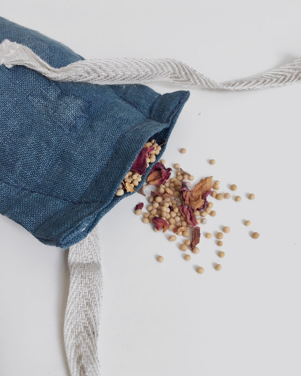 wellness eye pillow with mustard and rose petals