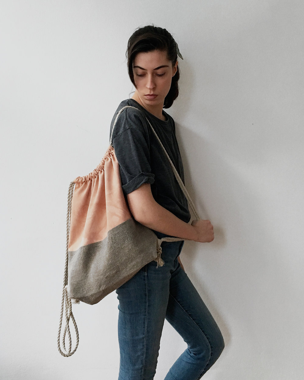 These sustainable drawstring backpacks were dyed with plants