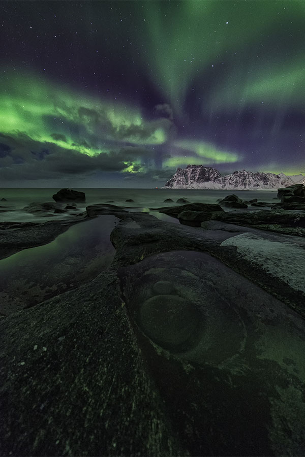 Northern Lights over the Dragon's Eye of Uttakleiv - Lofoten Islands, Norway