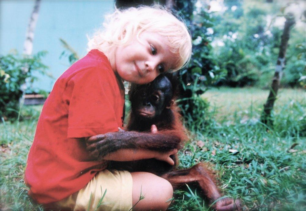 Savannah the orphaned orangutan and I hugging.