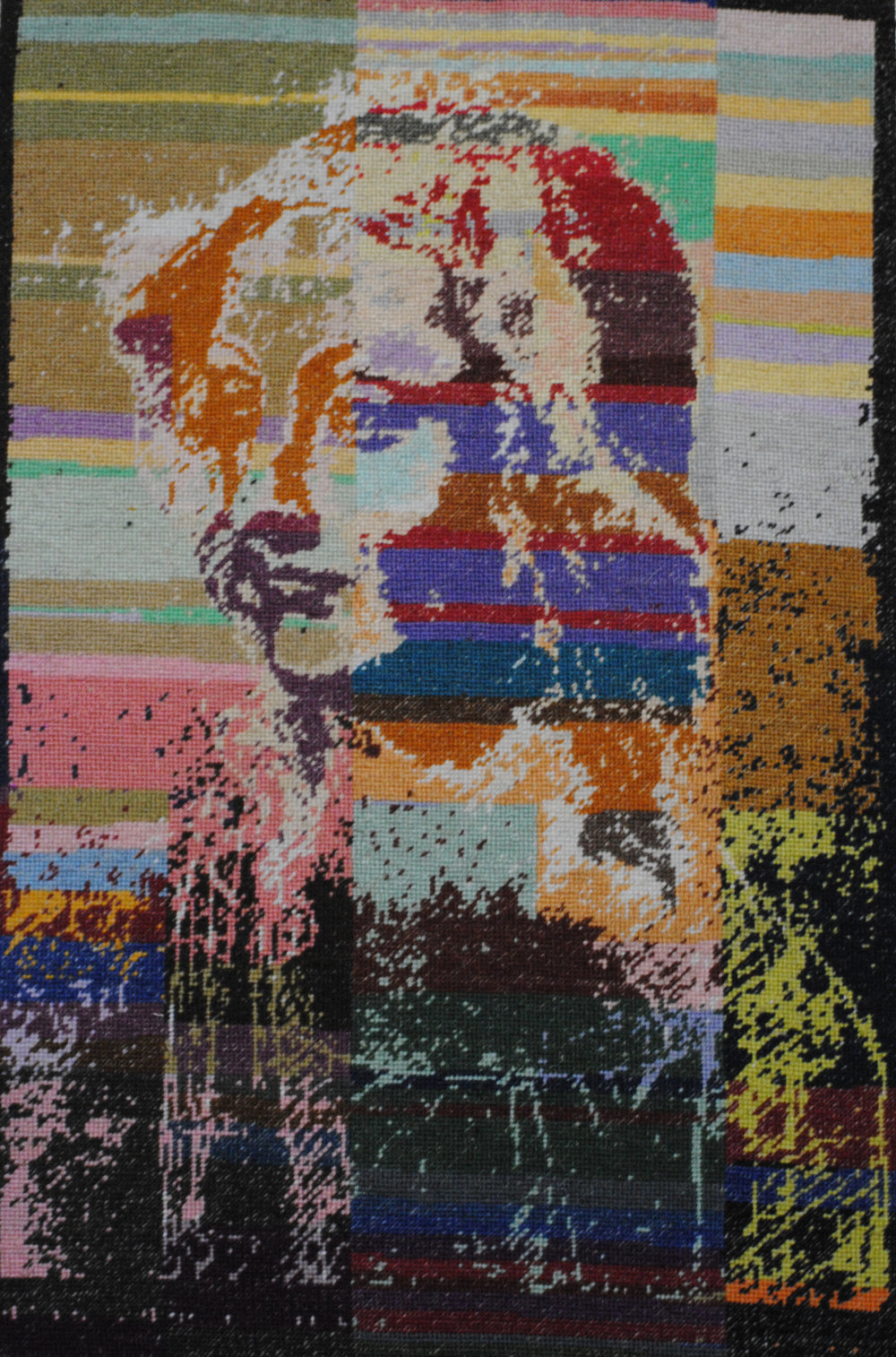 Holly Day's needlepoint is a rendering of one of Leonardo de Vinci's sketches. It shows the head and shoulders of a young man with long, loose hair. The outline and shadows are done in darker colors.