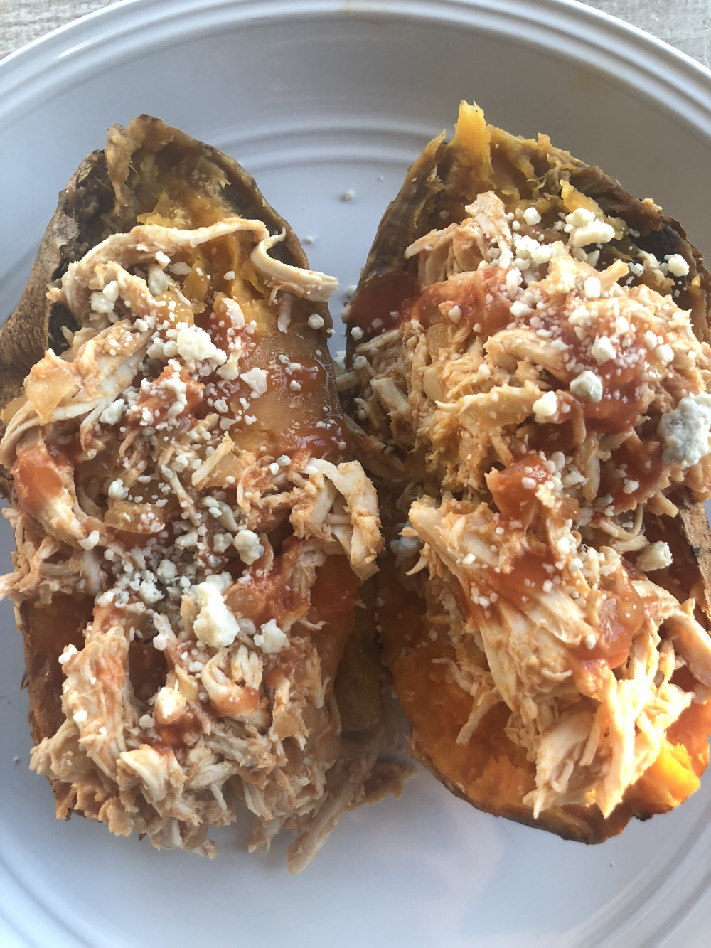 - Ingredients:3/4 C Hot Sauce (Franks)1 Tbsp & 1 tsp Coconut Oil1 1/2 lb Chicken Breast1/2 Medium Onion (Chopped)4 Small Sweet Potatoes (Scrubbed Clean)Sauce (Optional):Can eliminate and just top with Blue Cheese1/4 C Avocado Mayo or Plain Yogurt1 Tbsp Lime Juice1/4 tsp SaltDirections:1.) Melt 1 Tbsp Coconut Oil & mix with Buffalo Sauce2.) Add chicken to crockpot & drizzle with Buffalo Sauce mixture from step 1.3.) Melt 1 tsp coconut oil & rub or brush on skin of sweet potatoes.4.) Arrange sweet potatoes on top of chicken around edge of crockpot5.) Cover & cook on high for 4 hrs or low for 6 hrs or until chicken is cooked and potatoes are tender.6.) Sauce: Wisk together avocado mayo/yogurt, lime juice, salt (refrigerate until chicken and potatoes are done).7.) When cooked, remove potatoes from crockpot. Use tongs or gloves and be careful as potatoes will be hot and tender.8.) Remove chicken and shred.9.) Add shredded chicken back to pot, add remaining 1/4 C hot sauce and combine.10.) Slice sweet potatoes, top with shredded chicken, drizzle with hot sauce mixture in pot, top with sauce or top with blue cheese.