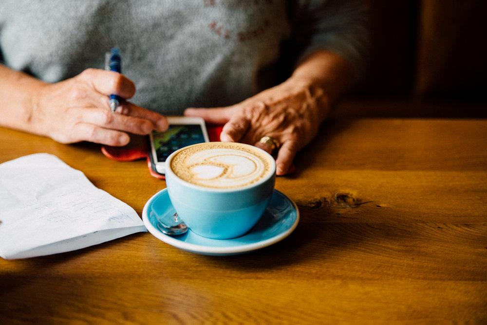 White Hart Lounge w: Customer Drinking Coffee.jpg