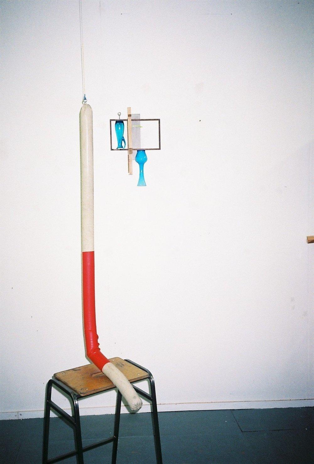 Michael Samuels,Spent, 2016, cast concrete sausage, heat-shrink , vintage stool (left) and Words Fail, 2017,ercol, cast concrete, scandinavian glass vases, cable ties (right)  Photography by Delilah Olson -