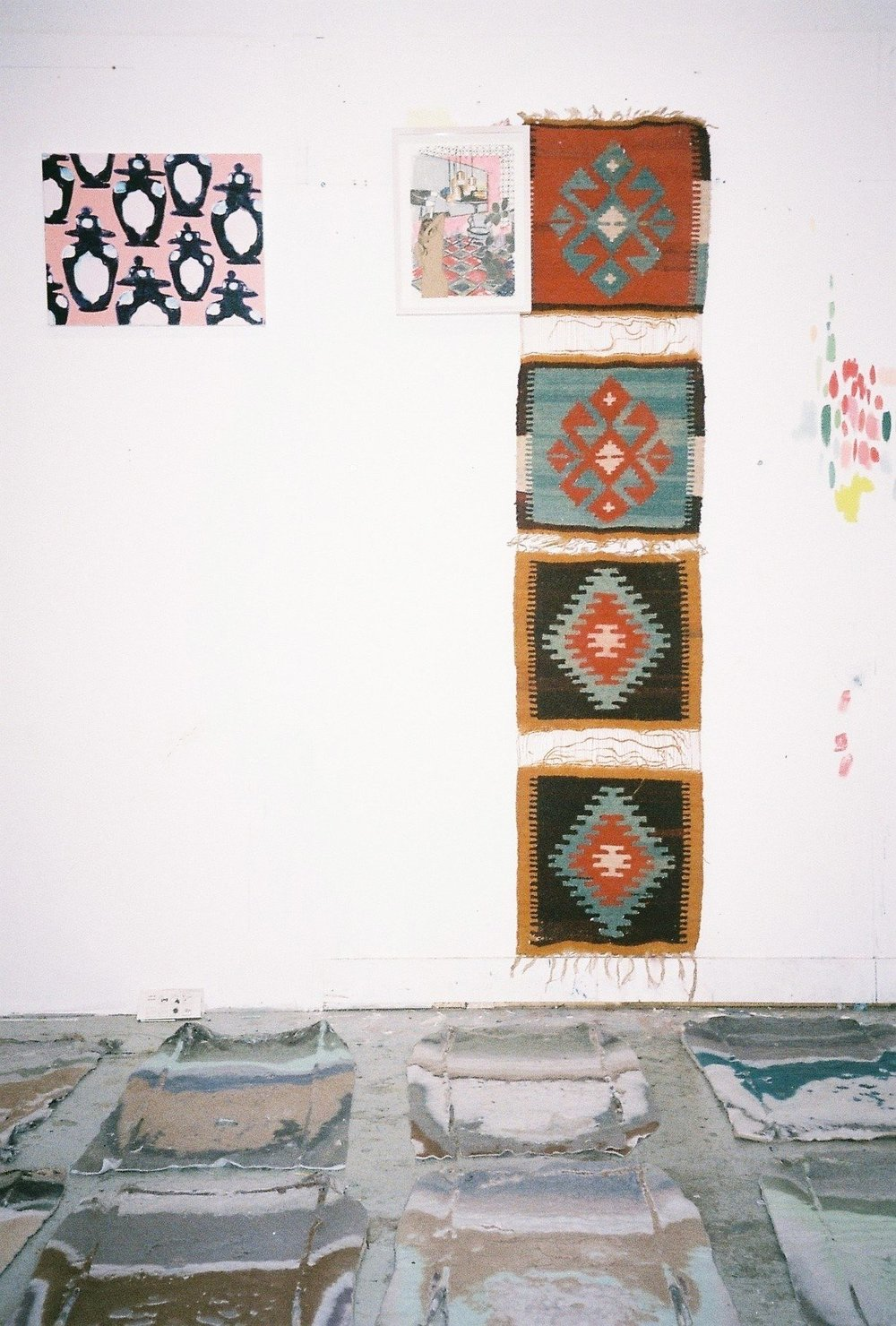 Sara Berman, Lint Sweaters in process (on floor), small painting on wall 'Penguin Soldiers 2017 46cm by 36cm oil in linen, framed Collage (on wall)-exploratory collage work, Iranian textiles (on wall)| Photography by Delilah Olson -