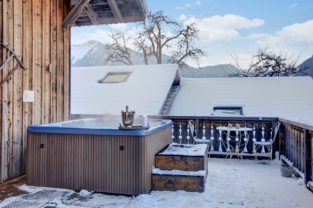 Outdoor hot tub on our sun terrace.