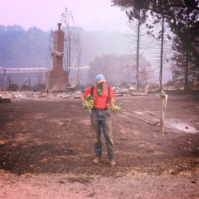 Photo of David Cooper of Oak Hill Farm who—along with Let's Go Farm, Flatbed Farm, Leisen's Bridgeway Farm and more—have suffered great losses in the past two days of fires. Photo credit: Community Alliance with Family Farmers
