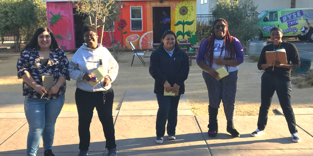 Pictured above from left to right: RYSE youth members and poets Marisol Lara, Nyree McDaniels, Carol Morales, Sukari Wright, and Leeah Thomas.