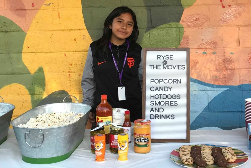 Clarisa supports during RYSE's outdoor movie night as part of our members and families appreciation week, October 2018.
