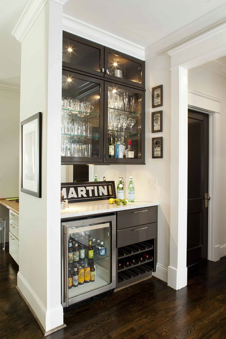 Courtesy Home Esthetics.  Have an awkward corner somewhere? Why not install some cabinetry and a small fridge. Add the glasses and the bottles and you have a great drink-serving area. You won't really need a sink, so plumbing is not required.