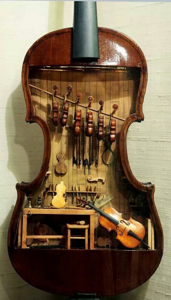 A miniature violin maker's workshop in an old open violin. A work of love. Source: Unknown