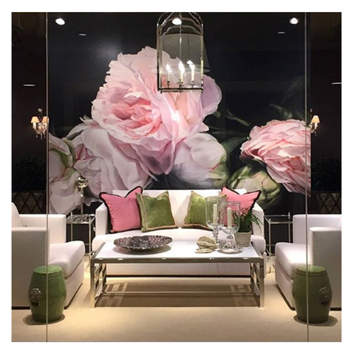 Webster & Company Showroom (US). Isn't this backdrop just perfect for the sofa and chairs? The pink and green pillows pick up the colours from the wallpaper.