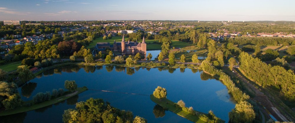 A bird's eye view of Hoensbroek, the town I grew up in. In the foreground is the pond where we would go skating in wintertime. The castle, Kasteel Hoensbroek, is now a cultural center and restaurant where my family and I celebrated my father's life after his funeral. In the upper left corner two high rises are visible. These were not around when I was young. It was a wooded area at the time and our house was just a block away. Such a beautiful place at that time. Source: Kasteel Hoensbroek
