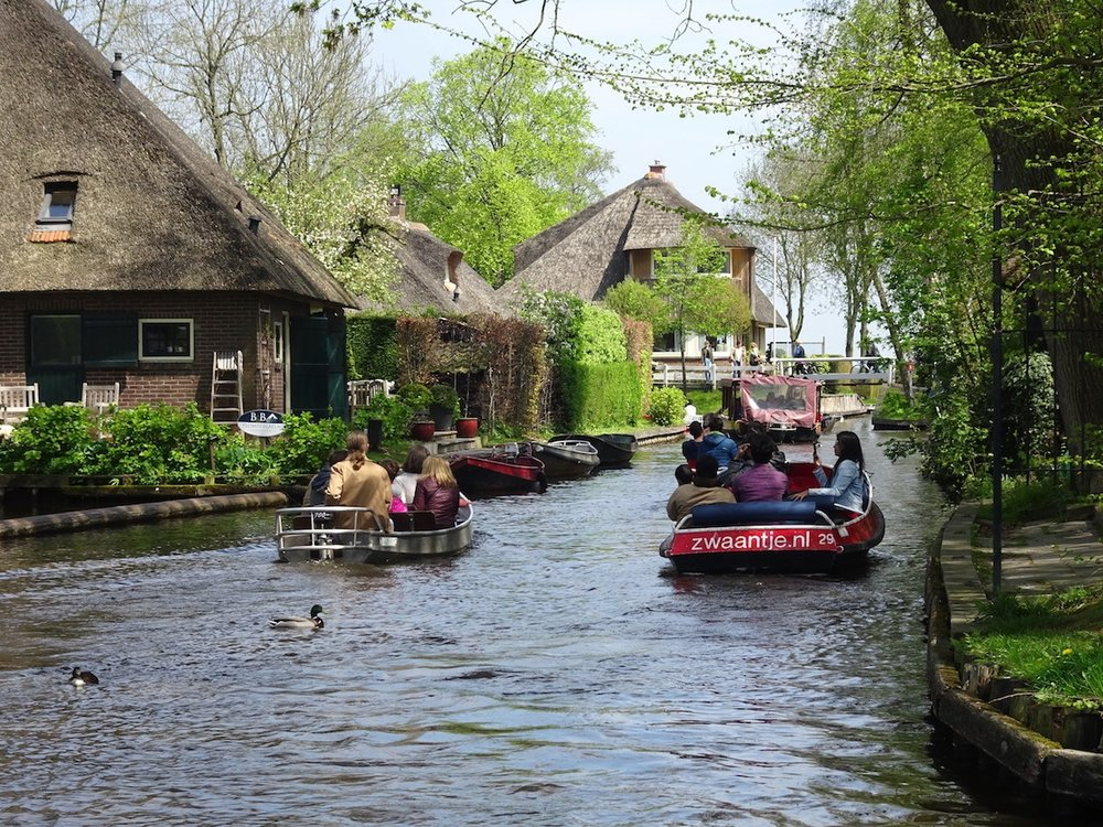Barges with Tourists in Giethoorn (The Netherlands)