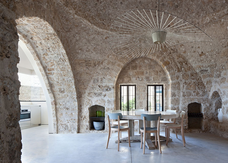 Two images of the Jaffa House by Pitou Kedem Architects. Note the Charlotte Lancelot rug in large cross stitch style in the upper photo .