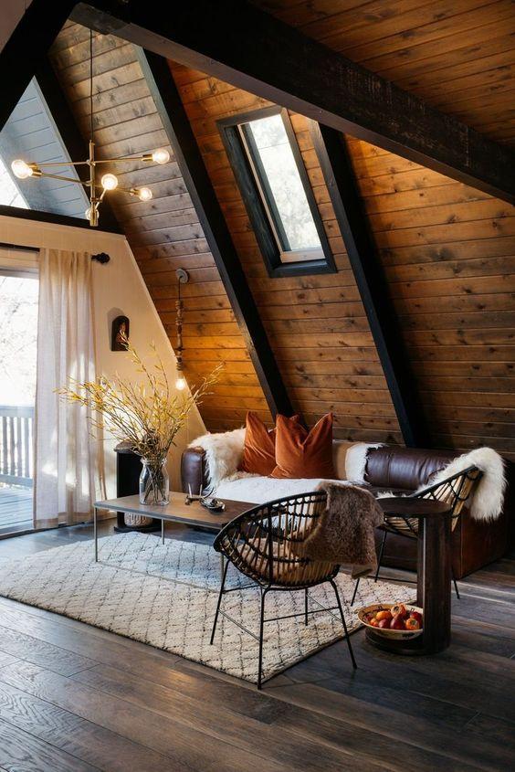 Sleek, modern chandelier in gold tones. Source: Dwell