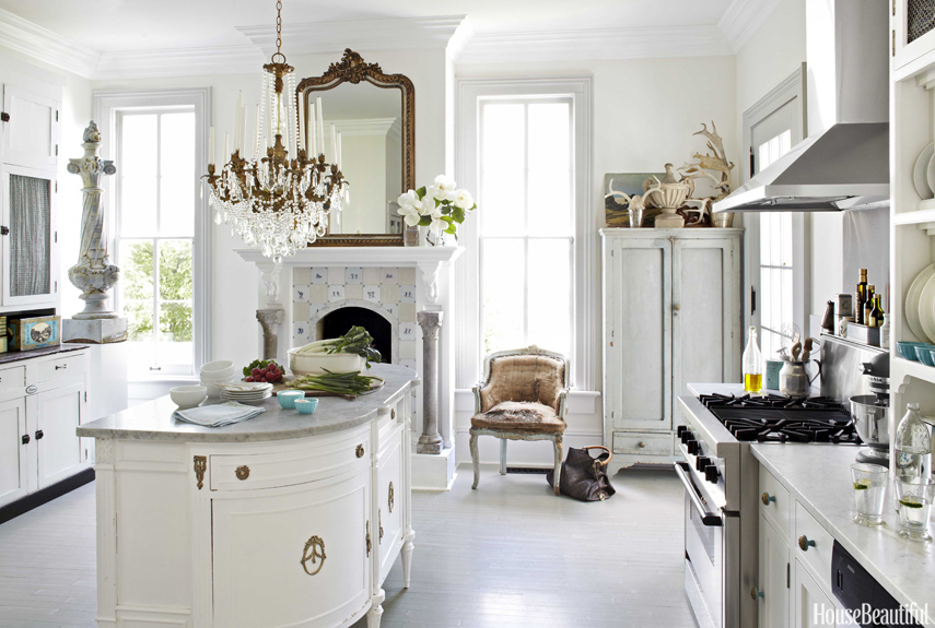 Traditional kitchen with fireplace! A tad too traditional for me, inviting nevertheless. Source: House & Beautiful.