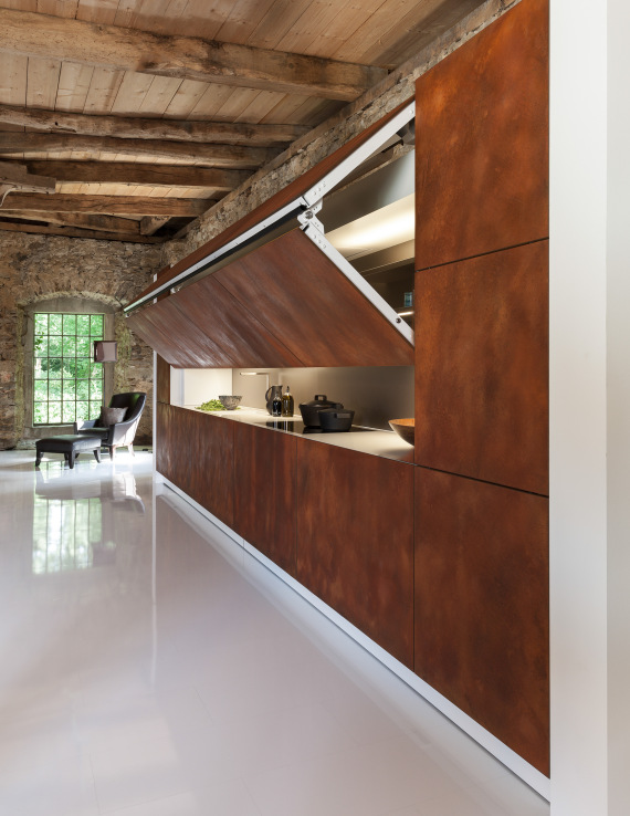 Built-In Kitchen by Per Warendorf. At the touch of a button your messes will disappear. And if your memory is as good as mine it will stay hidden for days on end.