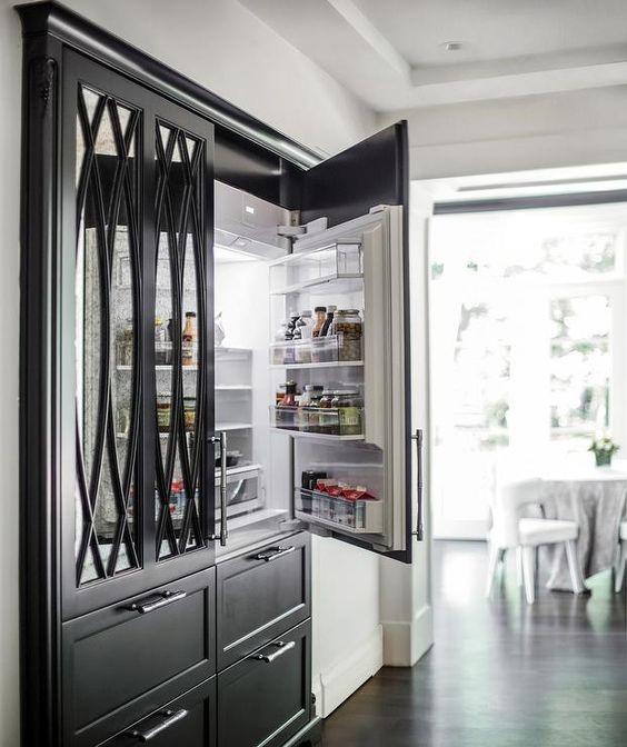 Beautiful custom doors with mirrored back for this built in fridge. Note the multiple freezer drawers. A fridge unit which looks like a piece of furniture! Source: Pinterest.