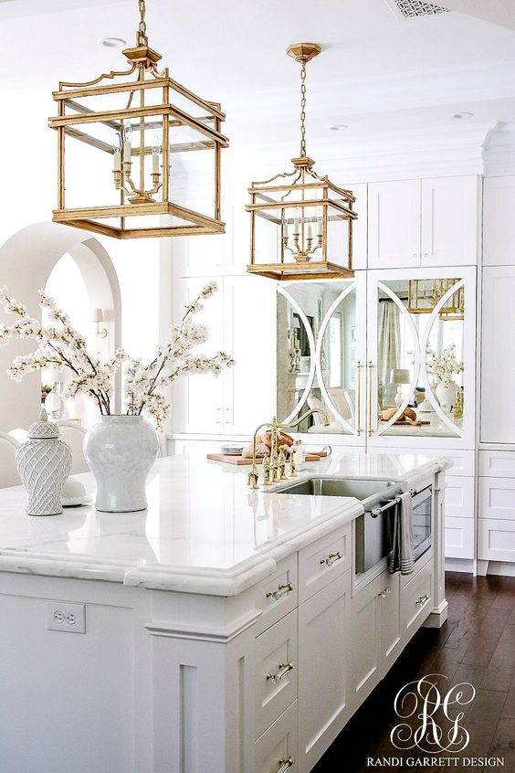 Gorgeous traditional kitchen with gold toned accents. Source: as shown.