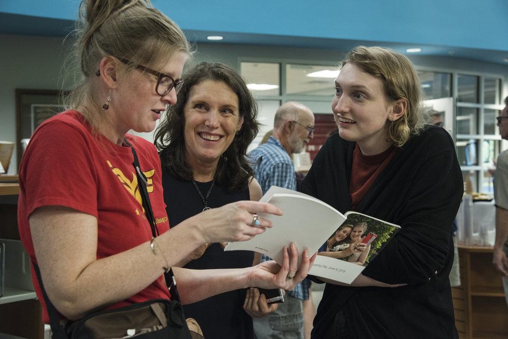 Delaware Humanities Grant Officer, Erin Samarasinghe, Festival Co-Chair, Jen Mason and her daughter, Clare.