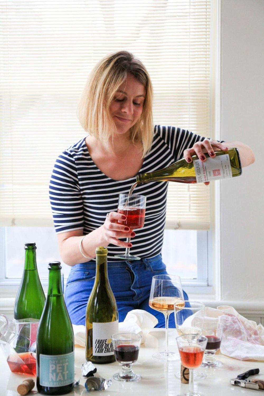 Rachel Signer bio shot_pouring wine.jpg