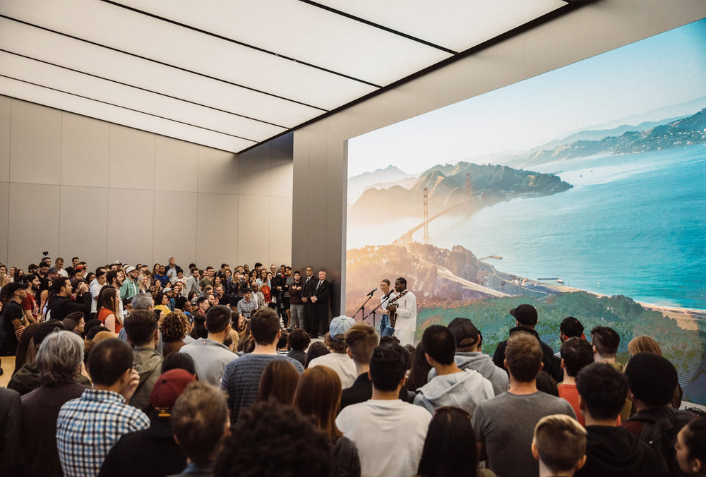 "Customers fill the Forum at Apple Union Square as Leon Bridges performs a special acoustic set with Brittni Jessie from his album ""Coming Home."""