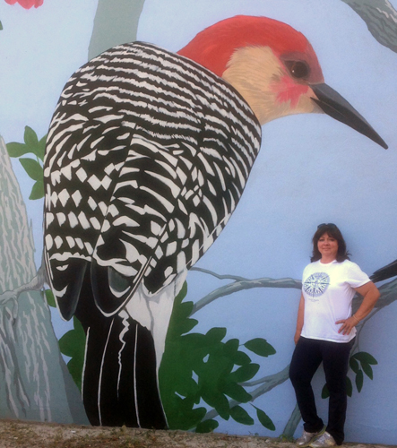 Carol Makris pictured here with a completed Red-Bellied Woodpecker.