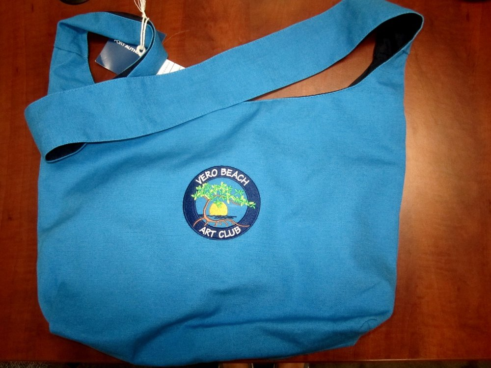 They have a new Shoulder Length Sling Tote in 4 two tone color combinations.