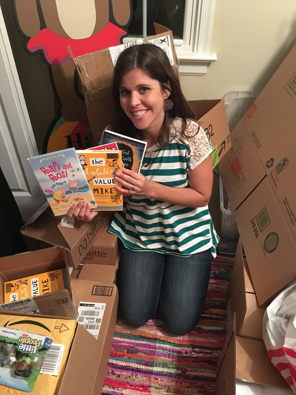 Caroline Neal, Founder of Worthdays, amongst the many boxes of generous donations of books.