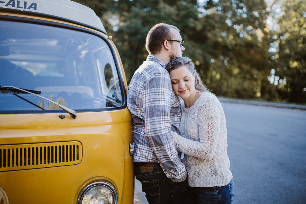 Couple posing with yellow VW bus, engagement session with Tessa Blackstone